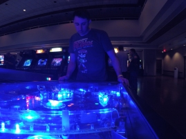 Playing in the blue lights of the machine.