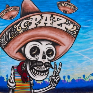 The mural on the side of Paz Cantina.